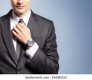 Close up of young handsome man in black suit