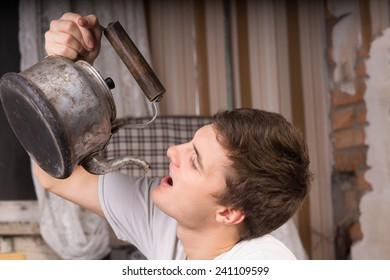 Close up Young Handsome Man Drinking From Vintage Kettle Inside a Room.