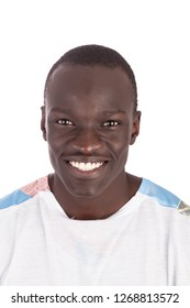 Close up young handsome Sudanese man face to camera in white tshirt smiling with white teeth showing, in landscape format with copy space isolated on white background. Metaphor for I want you