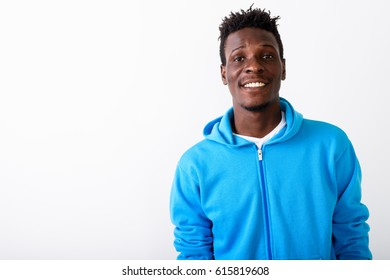 Close up of young happy black African man smiling against white background