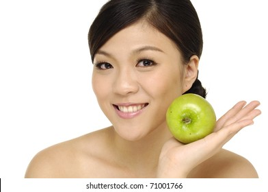Close up young happy woman with green apple
