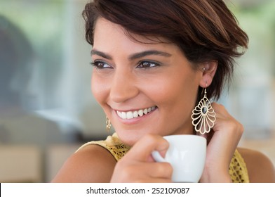 Close Up Of Young Happy Woman Holding Cup Of Coffee At Coffeshop