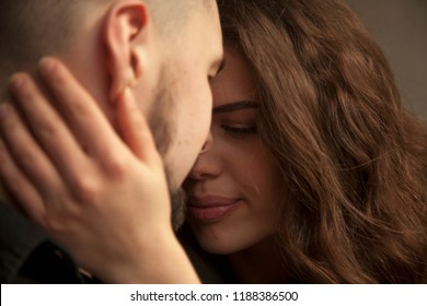 Close up of young loving couple getting closer to kiss each other, enjoying intimacy tenderness in love