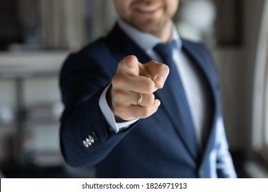 Close up young male human resources manager pointing finger at camera, choosing successful candidate for job position or opened vacancy, making employment offer, head hunting hiring process concept.
