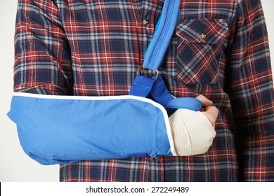 Close Up Of Young Man With Arm In Sling