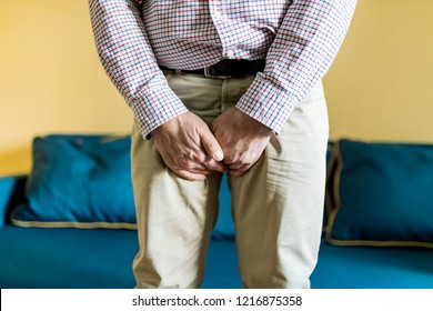 Close Up Young Man Holding His Genitals Cause Pain, Prostate Cancer, Premature, Ejaculation, Fertility, Bladder Problem. Man Hand Holding On Middle Crotch Of Trousers
