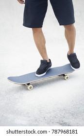 Close up young man skateboarding at a skate park