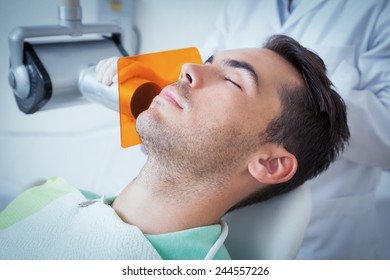 Close up of young man undergoing dental checkup in the dentists chair