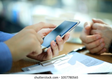 Close up of a young man using mobile smart phone