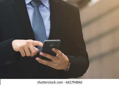 close up of Young Man using telephone. or Business man Contact Customer.