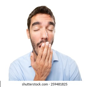 Close up of a young man yawning