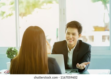 close up young manager businessman asking applicant woman for introduce herself before start job interview at loft modern office ,we're hiring concept