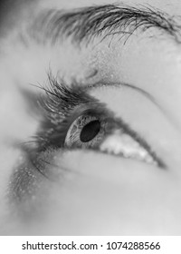 Close up of a young mans eye looking up