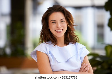 Close up of young mixed race businesswoman looking at camera