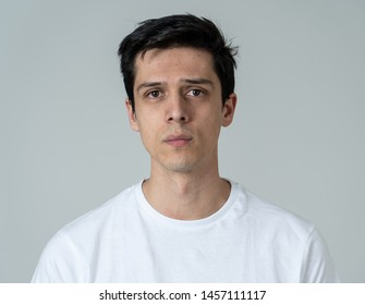 Close up of a young sad man, serious and concerned, looking worried and thoughtful. Feeling sorrow and depression. With copy space. In facial expressions and human emotions concept.