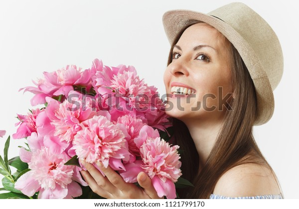 Close up young tender woman in blue dress, hat holding bouquet of pink peonies flowers isolated on white background. St. Valentine's Day, International Women's Day holiday concept. Advertising area
