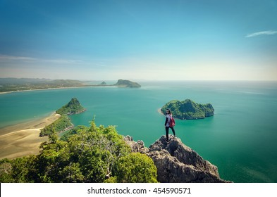 Close up young traveler girl standing on the top of mountain at Khao Lom Muak and enjoy the beauty of seascape, travel, freedom, Thailand.