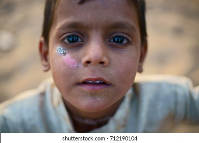 A close up of a young tribal boy at the Pushkar fair 2016. He is very poor and was seen begging for money. Held every year in the small town of Pushkar, Rajasthan, India.