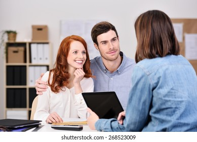 Close up Young White Couple Listening to a Businesswoman Talking About Business Plans with Tablet Computer
