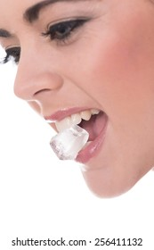 close up of a young white woman with an ice cube or block in her mouth