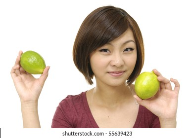 Close up young woman with green lime