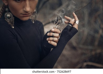 close up of young woman hands holding incense