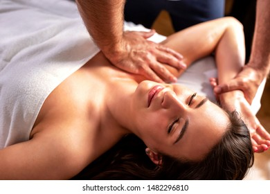 Close up of young woman having a relaxation massage wearing a white towel