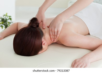 Close up of a young woman having a shoulder massage