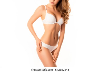Close up of young woman in lingerie showing perfect body.