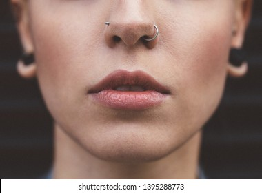 Close up of young woman with nose piercings