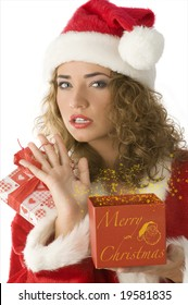 close up of a young woman with present box and christmas dress