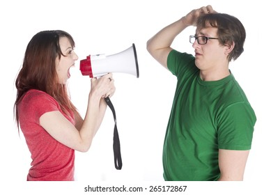 Close up Young Woman Shouting to her Man Scratching his Head with Megaphone, Isolated on White Background.