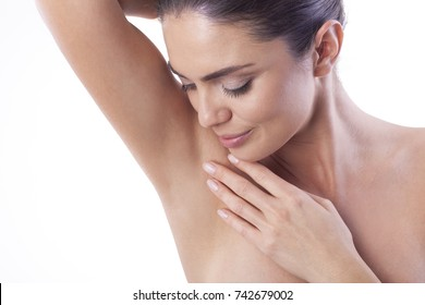 Close up of young woman showing her smooth armpit.