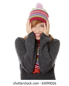 Close up of young woman with winter cap smiling at the camera isoalated on white background