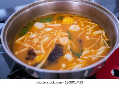 Close up of yummy tom yum goong soup boiled over a stove