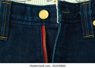 close up zipper of blue jeans