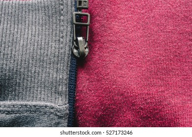 Close up to zipper on sports wear. Athletic cloth background
