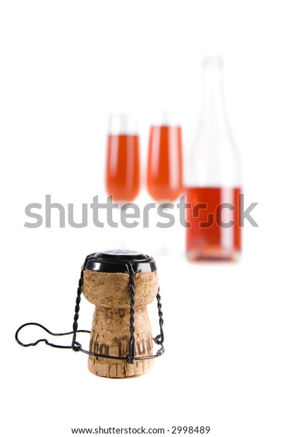 Close_up of a champagne cork with drinks in the background