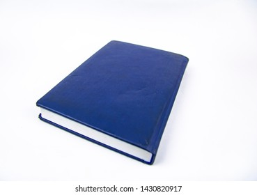 Closed agenda on a white background.