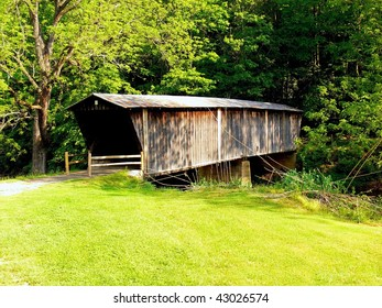 A closed antique wooden bridge over a river in the mountains of Virginia.