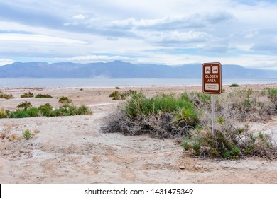 Closed area sign on  Salton Sea recreation area shore - no motor vehicles. Ecological catastrophy site.