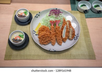Closed up artificial model of Tonkatsu set served with steamed eggs