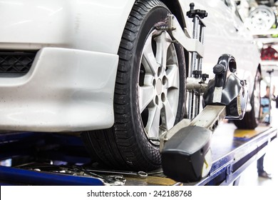 Closed up of an auto wheel that is undergoing wheel alignment