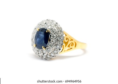 Closed up Blue Sapphire  with white diamond and gold ring isolated on white background, wedding ring and love concept.