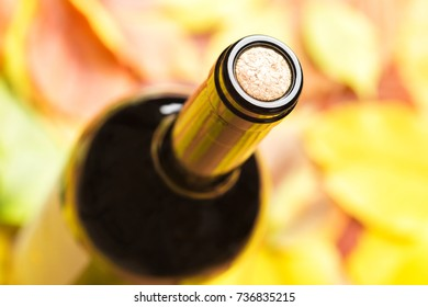 A closed bottle of red wine. Top view.