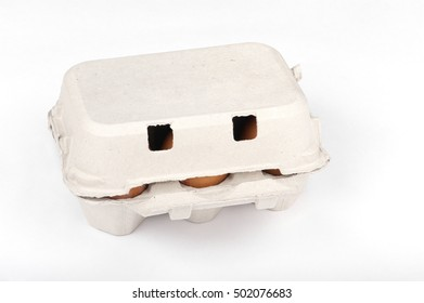 a closed box with eggs, closeup white isolated