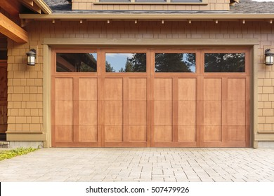 Closed brown garage door with windows