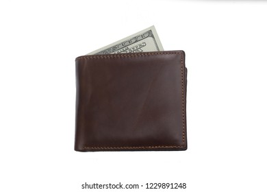 closed  brown  leather wallet with cash  dollars isolated