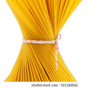 Closed up bunch spaghetti pasta tied with a rope of isolated on white background