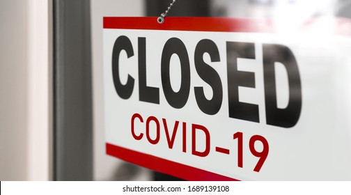 Closed businesses for COVID-19 pandemic outbreak, closure sign on retail store window banner background. Government shutdown of restaurants, shopping stores, non essential services.
